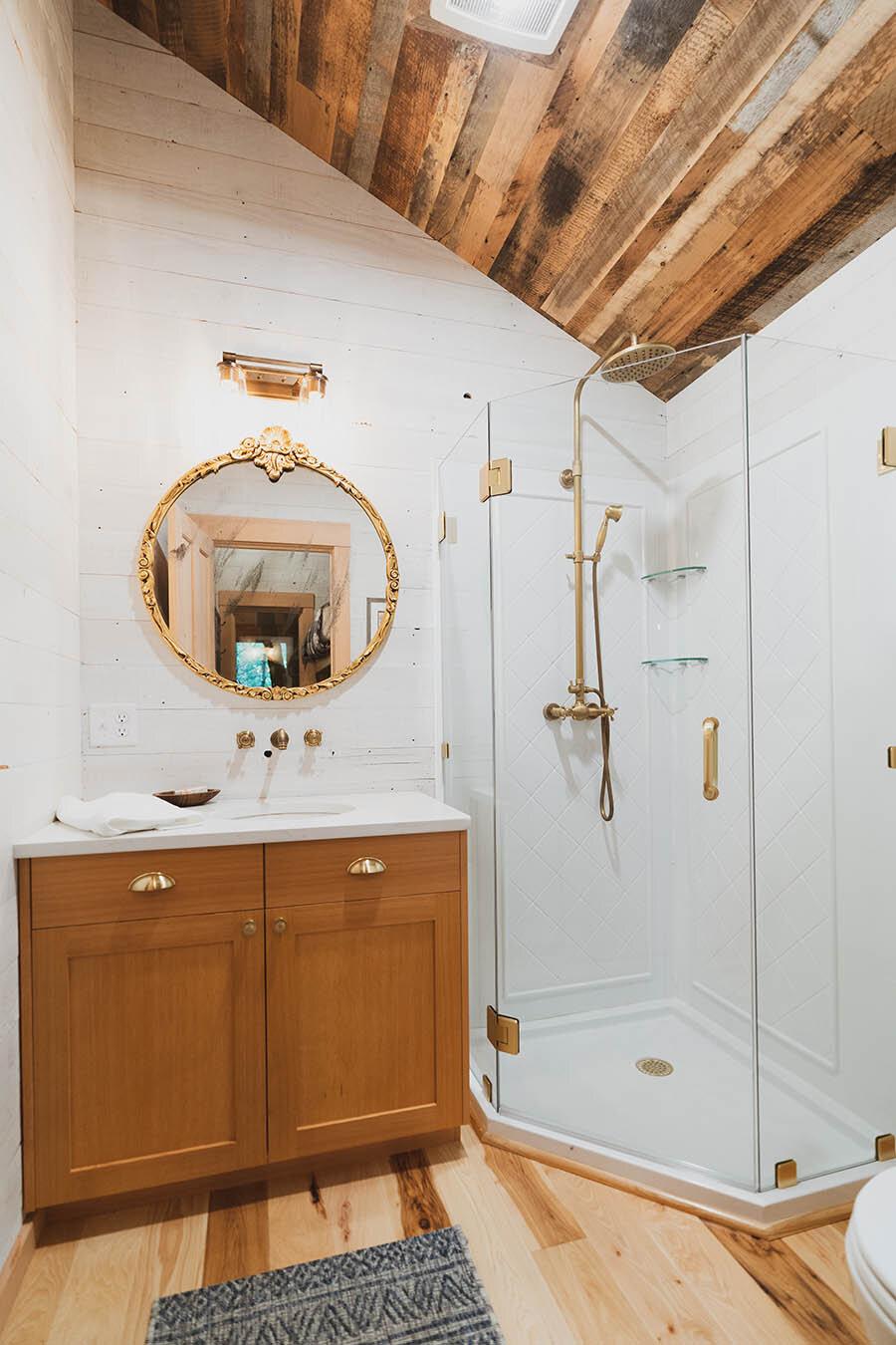 a tasteful 3/4 bathroom adjacent to the bunkroom